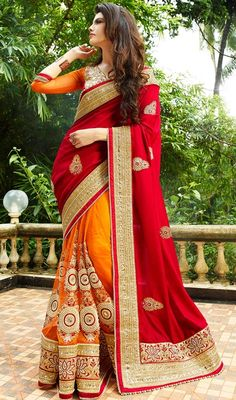 Become the grandstand beauty clad in this red and orange color georgette net half n half sari. This engaging attire is displaying some fantastic embroidery done with lace, stones and resham work.  #classicaldesignsaree #embroideredbuttaworksari #classicaldesignsarees