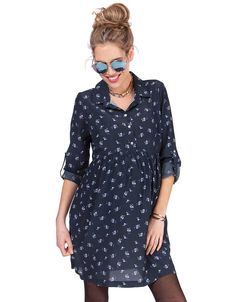 Soft woven fabric   Gently elasticated empire waist   Button down front for nursing  Pockets   Adjustable turn up cuffs     Feminine in fit, our Navy Floral Woven Maternity Dress is ultra-flattering and easy-to-wear. Made in soft woven viscose, the dress is gently cinched at the empire waist, then drapes beautifully over your curves, making the most of your new shape. Perfect before, during and after pregnancy, simple buttons open up at the front, to provide easy access for nursing after…