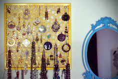 Perforated metal table repurposed into jewelry wall organizer http://www.curbly.com/users/chrisjob/posts/9116-how-to-make-a-jewelry-organizer-from-an-secondhand-table