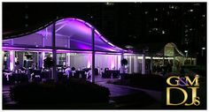 Ali & Hartz wedding at the Landing at Dockside. Purple uplighting was used to transform their River Room reception (this is the view from the Brisbane River). Wedding DJ, MC and Lighting design by G&M DJs   Magnifique Weddings #gmdjs #magnifiqueweddings #weddinglighting #docksideweddings #thelandingatdockside @gmdjs