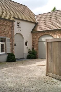 If a man's home is his castle, then your garage door is the drawbridge. The garage is your portal to the exterior world, where you store your car and extra Garage Door Styles, Garage, House Exterior, Garage House, House, Garage Doors, Rendered Houses, Barn Conversion Exterior, Garage Door Types
