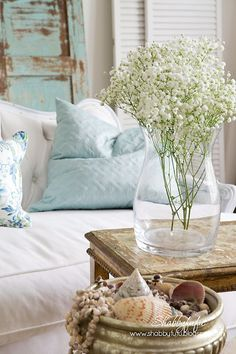 Shabbyfufu: Five Minute Styling Tips With HomeGoods Pillows and Art  Blog has great photography and shows how to change a neutral-all-white room in 5 minutes with accessories