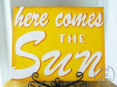 Now who doesn't need a bright reminder of the coming Spring then myself?!  Chicago dreariness has me down, it's time for: Lake Girl Paints: Here Comes the Sun - Handpainted Sign Tutorial