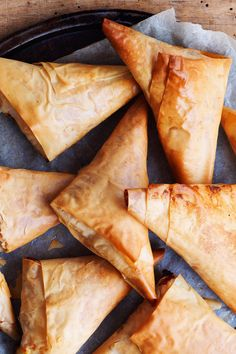 These delicious filo pastry triangles are crammed with smooth Cheddar and creamy ricotta cheese and make for a super simple kids' lunchbox treat or tasty afternoon snack. | Tesco