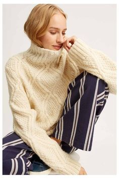 The Fishermans Jumper is back by popular demand. A best-seller because of its contrasting chenille, basketweave and cable-knit patterns that give it a sumptuous feel. This ivory wool piece has a slouchy shape. Offset the chunky textures with a slim leg trouser or pencil skirt.