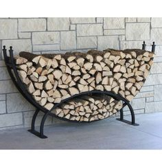 Crescent Firewood Rack! Need to check Home Depot, maybe they'll have them on clearance once Spring gets here.