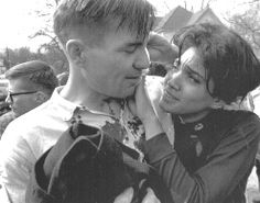 """[Photographer unknown] Juniata College student leader Harriet Richardson and """"poet-in- residence"""" Galway Kinnell after being beaten on the student march. College officials had opposed their participation and ordered them to remain at school.  They came anyway."""