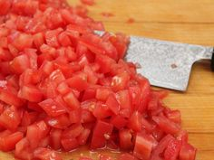 Peeling and dicing fresh tomatoes is a great technique to know for when you want those tomatoes to melt into a sauce or a soup, if you plan on canning them whole, or if you're making a very delicate tomato sauce where seeds would ruin the texture. It was one of the first techniques I learned at my first Italian-restaurant job, and one that I performed nearly every single day. It's especially useful this time of year, during prime tomato-canning season.