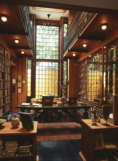 Classic 2 story Study with Library Loft. Spectacular window wall...I'd lose Mr S for days w/ a libarary like this -- he'd go back to reading actual books instead of via iPad LOL