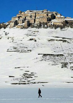 """Castelluccio di Norcia, Perugia, Umbria, Italy. The village lies at 1452 m, making it the highest settlement in the Apennines. It lies above the """"Great Plain"""" (Piano Grande) [https://en.wikipedia.org/wiki/Castelluccio_(Norcia)]"""