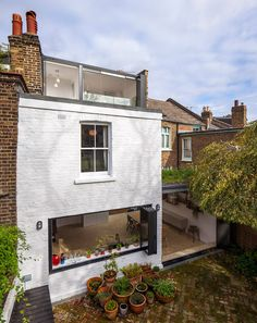 Studio 30 has transformed a terraced house in west London with a new loft bedroom and an enlarged family kitchen, both featuring walls that fold open to offer better views of a garden and nearby park Terraced House, House Extension Design, Roof Extension, House Design, Loft Design, Design Design, Victorian Terrace, Victorian Homes, Victorian Kitchen