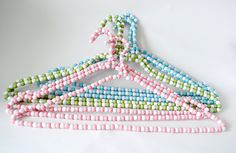 """Hand beaded hangers by toriejayne, via Flickr... this could make an adorable baby gift, using pink or blue """"crystal"""" beads"""