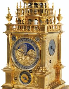 """SOLD.  EUR 81,000 - Large brass table clock or """"turmchenuhr"""" with large ring, German work by  Samuel Hauckh , Augsburg, circa 1615  A GILT-BRASS GREAT RING TURMCHENUHR, SAMUEL HAUCKH, AUGSBURG, CIRCA 1615"""
