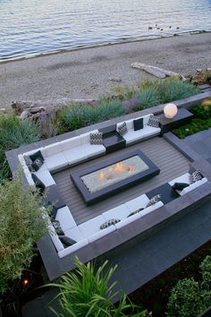 This ocean side terrace renovation in the Cordova Bay area was completed in 2014. The stylish sunken fire table lounge replaces a d...