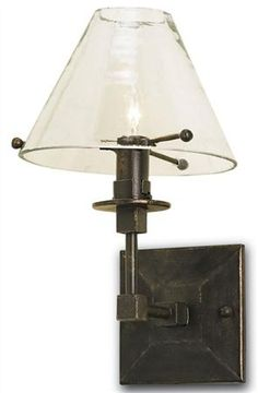 Kiran Wall Sconce Right by Currey & Company at The Garden Gates The Kiran Wall Sconce is handcrafted by Currey and Co. artisans for the highest end in luxury home lighting. The wrought iron base exends into the glass lamp for a simplistic yet sleek style. A Bronze Gold finish perfects the look for an exquisite piece that looks incredible on any wall in your home.  - See more at: http://www.thegardengates.com/Kiran-Wall-Sconce-5127-p27245.aspx#sthash.Gcl205JF.dpuf