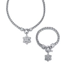Penina Rhodium Necklace w/Removable Flower centerpiece and Bracelet - Accent your style with a beautiful piece of costume jewelry. Make the perfect outfit complete with this Rhodium Necklace w/Cubic Zirconia Removable centerpiece and Matching Bracelet.