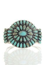 Native Turquoise Cuff from Lucky Brand -  An authentic reproduction of American Indian-made jewelry, this bracelet cuff features faceted turquoise stone teardrops set elegantly into antiqued-finish silver metal.