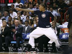 Miami Heat's Michael Beasley celebrates after teammate LeBron James scored two points against the Los Angeles Clippers during the second half of an NBA basketball game in Miami, Thursday, Nov. 7, 2013. The Heat won 102-97. (AP Photo/J Pat Carter)