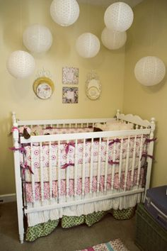 Might use already-owned light yellow paint from master bedroom for the nursery to save $$, but also I love the hanging orbs above the crib!  Still haven't decided what to do, but I will be DIYing a mobile or something like this...