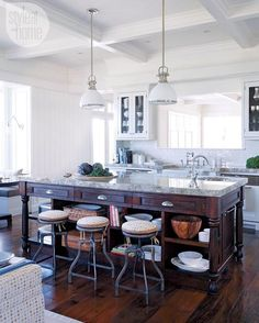 """This kitchen's comfy, eclectic vibe was created by mixing elements like a farmhouse-style sink, vintage faucets and industrial-inspired stools. Take a…"""