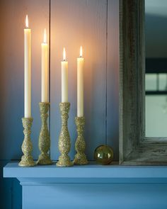 Make plain candlesticks sparkle with a coat of shimmery glitter.