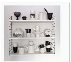 STRING FURNITURE SHELVING SYSTEMS The creative shelving units from String Furniture designed by Swedish architect Nils Strinning in 1949 are still modern and popular today. Shelving Systems, Furniture, Adjustable Height Desk, Shelves, Freestanding Storage, White Paneling, Indoor Decor, System Kitchen, Shelving