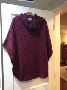 chunky cable-knit sweater poncho with loose turtleneck collar. This is adorable!
