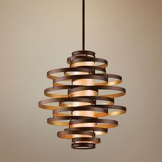 Vertigo pendant. Saw these on a design show hanging over the bedside tables, instead of lamps. Looked really nice.