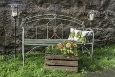 Crates, green metal garden bench, free standing metal candle holders