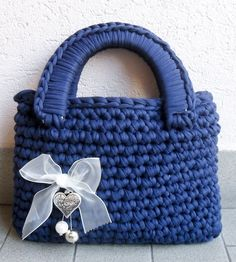 How to create a crochet bag with ribbon Authoress: Chiara&Tizy Materials – 700 gr of cotton (or wool) ribbon (for sale here) – crochet hook nr. 12 – a couple of stiff handles – one brooch or other decorations Advices Don't worry if the ribbon ball finishes: with good bobbles – that have to stay inside...