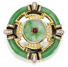 Jadeite Brooch | David Webb Center is a replica of an ancient Chinese coin, studded with a cabochon ruby, set throughout with round diamonds framed by carved jadeite segments, applied with black enamel. Art Deco