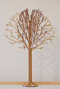 Tree #2 with an elegant delicate details is a laser cut set of 6 MDF wood panels which slot together to stand free on a desk, a shelf or mantelpiece at