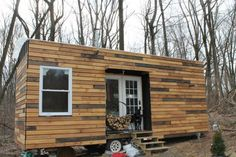 This beautiful tiny house was built on a demolished camp trailer's frame.  nathans tiny house on wheels 04 600x400   Nate and Jens Home on Wheels: Living Simply and Free in a Tiny House