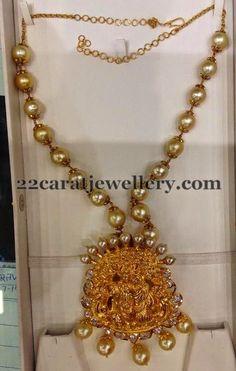 Jewellery Designs: Radha Krishna Locket with Pearls Chain