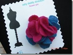 Check out our pink and blue felt flower pin! It looks fantastic with the coordinating Carnival Scrappy Scarf!