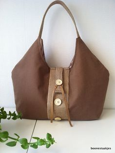 Brown cotton canvas hobo bag, shoulderbag.  Decorated with jute/ burlap, 3 buttons and a ribbon.  Reinforced and lined with striped cotton.  5