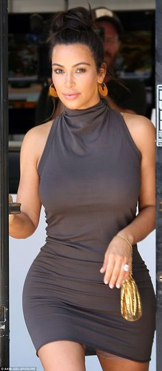 Kim's secret: As she left the hair salon, the reality star's skirt rode up, revealing the briefest of glimpses at the shapewear she wore beneath