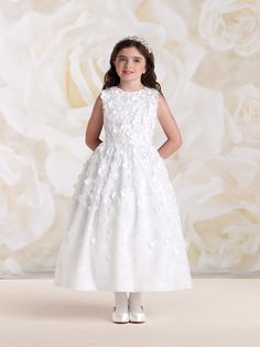 Sleeveless lace and satin tea-length A-line dress with jewel neckline, lace overlay bodice is encrusted with three-dimensional satin flowers and hand-beading, lace overlay gathered dirndl skirt features matching cascading flowers, suitable as a flower girl dress, party dress or First Communion dress. NEW for Spring 2015: White.Sizes: 2 – 14