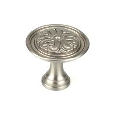 This dull satin nickel finish round cabinet knob with iris floral design is a part of the Iris Series from Century Hardware. A perfect blend of craftsmanship in traditional and contemporary design to complement any decor.