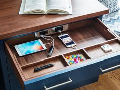 This kitchen desk designed by Sarah Robertson of Studio Dearborn is all about kitchen organization and desk storage.  The Docking Drawer charger outlet enables in-drawer charger of electronics include phones calculators and ipads.  Benjamin Moore Van Deusen Blue desk cabinetry is offset with warm wood walnut countertop.    Desk organization at its best! Make this a priority in your kitchen remodel.  #kitchenorganization #kitchendesk #kitchendesign #workfromhome #chargerdrawer #dockingdrawer
