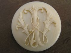 Ivory button. Such lovely detail.