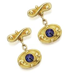 PAIR OF 18 KARAT GOLD AND CABOCHON SAPPHIRE CUFFLINKS, T.B. STARR, CIRCA 1900 Set with cabochon sapphires weighing approximately 4.50 carats, gross weight approximately 19 dwts., signed T. B. Starr, N.Y.