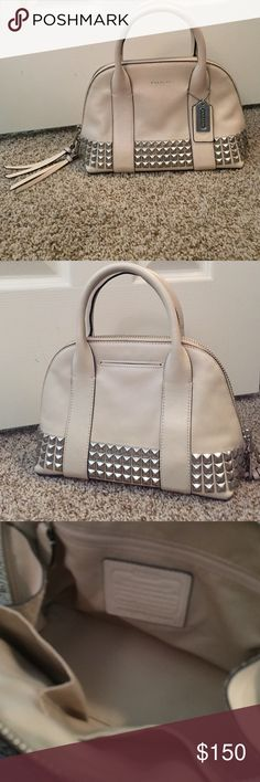 COACH PURSE Taupe colored w/ silver studs around the entire base of the purse. Not a large bag, but plenty of room for the essentials. It has only been used once or twice due to my preference of smaller wallets rather than an actual purse. Coach Bags Shoulder Bags
