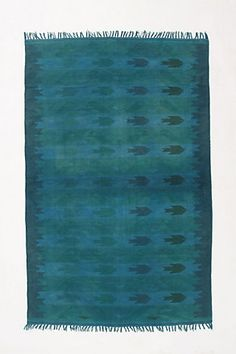 Cerulean Sea Rug - piscine shapes swim across a over-dyed dhurrie - from Anthropologie $298