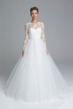 Chantilly lace bodice with long sleeves and soft tulle ballgown. Available in Ivory.