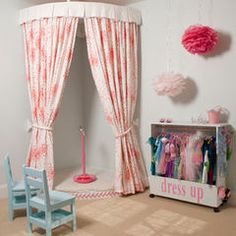 I want one of these curtain thingies stacked with cushions inside it for a reading corner!