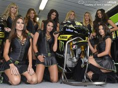 Monster Energy Girls stop to snap a picture in the Monster Yamaha Tech 3 garage. Description from motorcycle-usa.com. I searched for this on bing.com/images