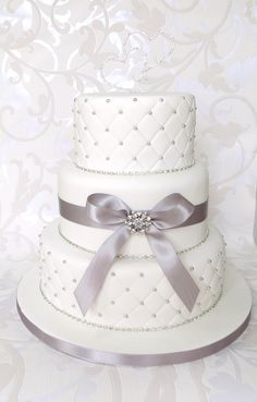 White Quilted Wedding Cake, with Diamantes, Brooch and Bow, with duo love heart topper
