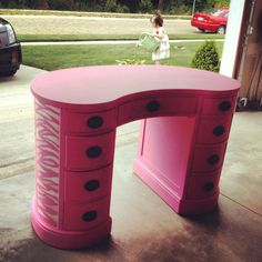 Antique vanity with hot pink chalk paint and silver zebra striping.