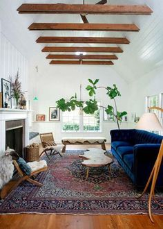 An Expert Guide to Buying Vintage Sofa, attic decor, ceiling beams, blue velvet sofa.